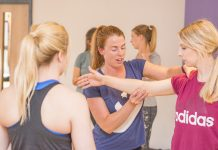 Teacher being guided on a dance movement by YDance instructor